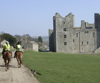 Riding past Bolton Castle
